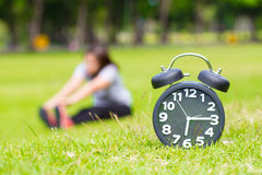 Exercise in the morning and black clock Stock Images