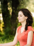 Exercise in nature. Young woman trying a breathing exercise in nature Royalty Free Stock Photo