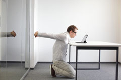 Exercise during office work Royalty Free Stock Image