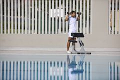Exercise at poolside Stock Photography