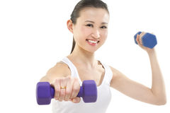 Exercise punch. A beautiful Asian woman exercising with hand weights. Photographed in studio Stock Photography