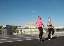 Exercise on the roof. Two young exercise on the roof Royalty Free Stock Images