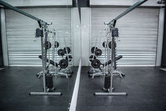 Exercise room with shutters and mirrors Stock Photo
