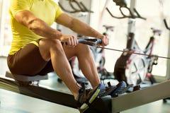 Exercise on row machine Stock Photography