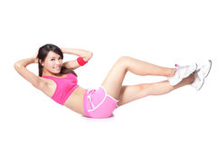 Exercise sport woman doing situps. Workout training in full length isolated on white background. Asian sport fitness woman smiling cheerful and happy looking at Royalty Free Stock Photos