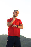 Exercise sports man checking pulse with watch Royalty Free Stock Photography
