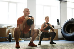 Exercise on squats Stock Photography