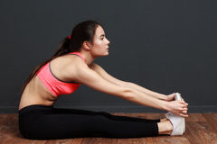 Exercise and stretching - Fitness woman grabbed with both hands Royalty Free Stock Photos