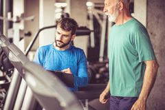 Exercise on track machine. Royalty Free Stock Photography