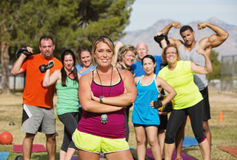 Exercise Trainer with Folded Arms. And happy group royalty free stock image