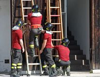 Exercise and training of firefighters in the fire station with w Stock Photography