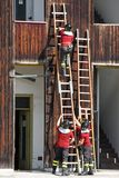 Exercise and training of firefighters in the fire station with w Stock Images