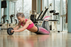 Exercise Whit A Ab Roller Stock Image