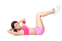 Exercise woman doing situps. Workout training in full length isolated on white background. Asian sport fitness woman smiling cheerful and happy looking at Royalty Free Stock Photography