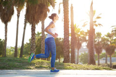 Exercise woman jogging outside Stock Photo