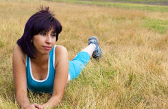 Exercise Woman rests. Relaxed woman rests after doing sports outside Stock Images