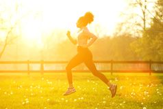 Exercise woman running outdoors Stock Images
