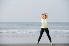 Exercise woman smiling at the beach Royalty Free Stock Photo
