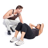 Exercise woman with trainer Royalty Free Stock Photo