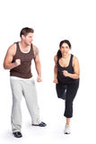 Exercise woman with trainer Royalty Free Stock Image