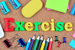 Exercise word on cork board Royalty Free Stock Photos