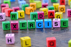 Exercise word on table Royalty Free Stock Photos
