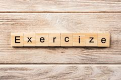 Exercise word written on wood block. exercise text on table, concept royalty free stock images