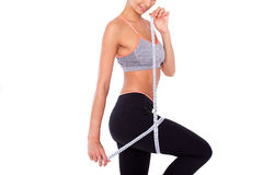 Exercise is working!. Cropped shot of a woman taking her measurements isolated on white Stock Photography