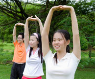 Exercise. Young asian adults exercise in the park Stock Image