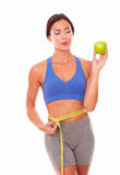 Exercised slim lady dieting on fruits Stock Image