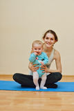 Exercises  with baby Stock Photography