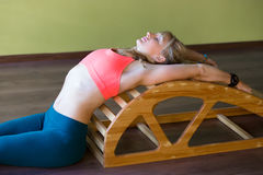 Exercises for back on yoga backbender Royalty Free Stock Photography