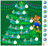 Exercises for children - help teddy bear decorate the Christmas tree.  Royalty Free Stock Images