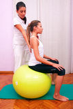 Exercises control basin trunk with bobath ball fitball stabiliza. Tion exercises in studio Stock Photography