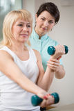 Exercises with dumbbells Royalty Free Stock Images