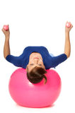 Exercises with dumbbells on a gymnastic ball Royalty Free Stock Images