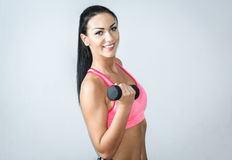 Exercises with dumbbells Stock Photography