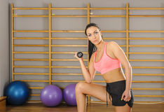 Exercises with dumbbells Stock Photos