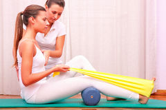 Exercises with elastic strengthening tibial tarsal Royalty Free Stock Photography