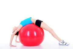 Exercises with fitball. Young beautiful pretty girl doing physical exercises with fitball Royalty Free Stock Photography