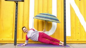 Exercises Fitness to Strengthen the Abdominal. Concept With Umbrella. stock video