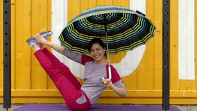 Exercises Fitness to Strengthen the Abdominal. Concept With Umbrella. stock footage