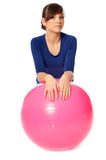 Exercises on a gymnastic ball Stock Photos