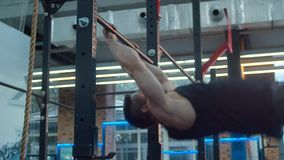 Exercises on the horizontal bar. Bodybuilder in the gym. Slow motion stock footage