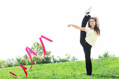 Exercises with red ribbon Royalty Free Stock Images