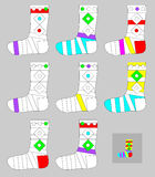 Exercises for young children - need to paint all socks by the same colors. Stock Photography