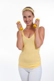 Exercising. Beautiful young woman with dumbbells Stock Images
