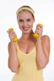 Exercising. Beautiful young woman with dumbbells Stock Image