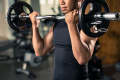Exercising with barbell Royalty Free Stock Photos