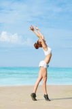 Exercising on the beach Royalty Free Stock Photography